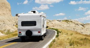 RV on road during sunny day © iofoto/Shutterstock.com