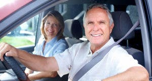 Happy senior couple in a car © kurhan/Shutterstock.com
