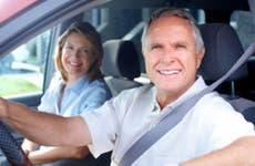 Happy senior couple in a car © kurhan/Shutterstock.com