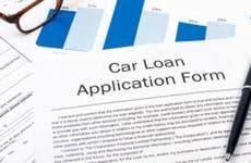 Can loan application form on desktop with glasses © Mert Toker/Shutterstock.com