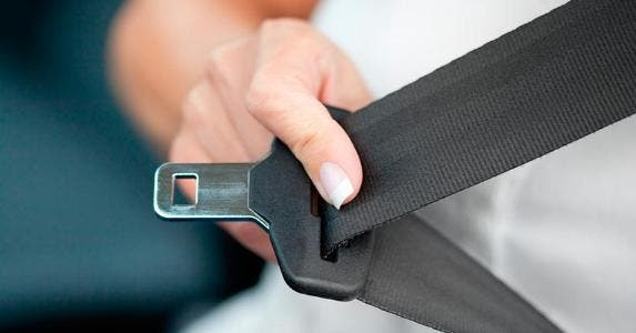Putting on seat belt | Deepblue4you/E+/Getty Images