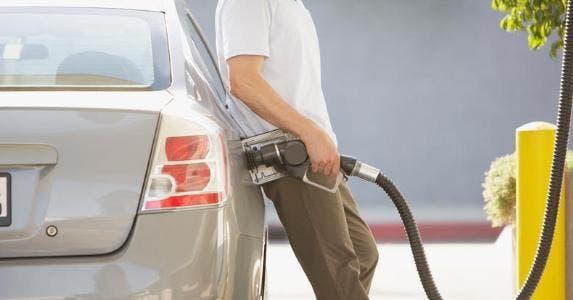 Man filling his car's gas tank | Tom Merton/OJO Images/Getty Images