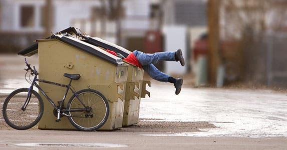 Dumpster diving in cemeteries? © Stephen Mcsweeny/Shutterstock.com