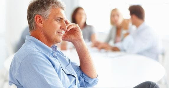 Man sitting in work meeting