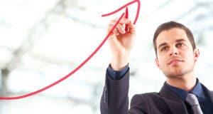 Businessman drawing a rising arrow © Minerva Studio/Shutterstock.com