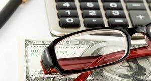 Calculator, eyeglasses and a $100 bill  © doomu - Fotolia.com