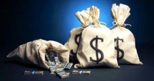 Bags of money in dark blue background © Fer Gregory/Shutterstock.com