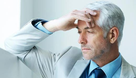Mature businessman feeling stressed out