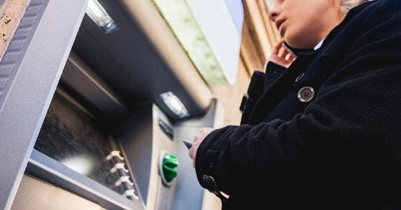 Woman using an ATM   iStock.com