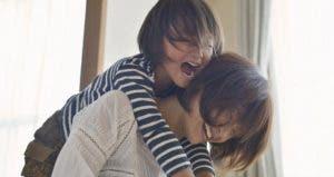 Parent giving her daughter a piggyback ride | Yagi Studio/DigitalVision/Getty Images