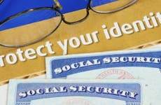 Social Security cards with protect your identity document © JohnKwan/Shutterstock.com