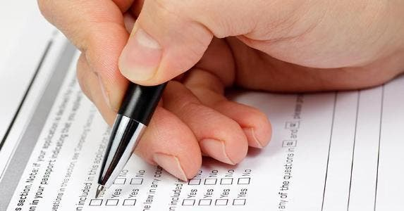 Hand with pen over blank checkboxes in a form © Dmitry Naumov/Shutterstock.com