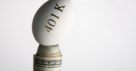 401(k) egg balanced on roll of money © iStock