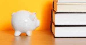 Piggy bank with books © iStock