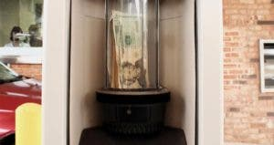 Money in banking drive thru tube | fullvalue/GettyImages