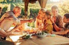 Large family eating dinner outside | Geber86/Getty Images