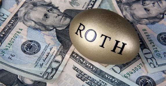 Golden Roth IRA egg on money © iStock
