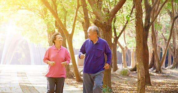 Elder couple walking outdoors © iStock