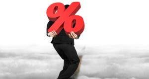 Businessman carrying percentage sign on his back © iStock