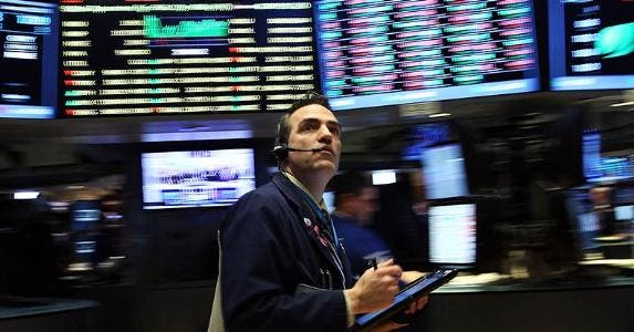 Stock trader on the floor | Spencer Platt/Getty Images