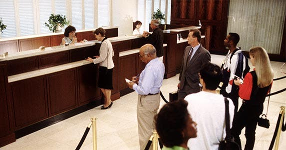 Bank tellers | Chuck Savage/Getty Images
