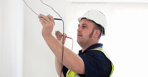 Telecom cable installers/repairers | Hugh Sitton/Getty Images