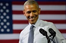 Smiling Obama in podium | Evan El-Amin/Shutterstock.com
