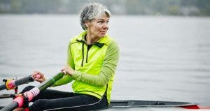 Mature woman sculling | Thomas Barwick/Getty Images