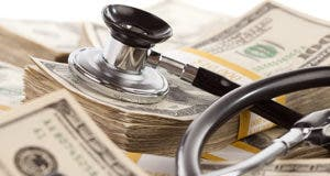 Stethoscope on money © Andy Dean Photography/Shutterstock.com