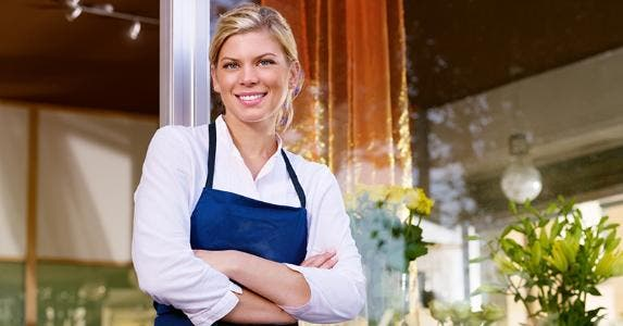 Smiling woman shopkeeper © Diego Cervo/Shutterstock.com