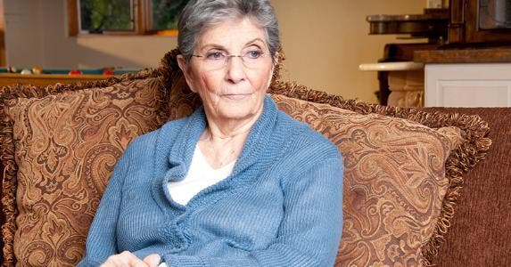 Senior woman seated on her couch © iStock