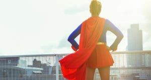 Woman standing on rooftop wearing a superhero outfit   Robert Daly/Getty Images