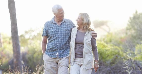 Senior couple enjoying a walk | iStock.com/Squaredpixels