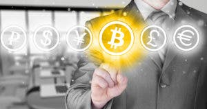 Businessman selecting highlighted bitcoin © Nata-Lia/Shutterstock.com