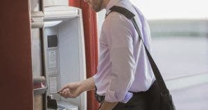 Man inserting card into ATM | Mint Images RF/Getty Images