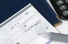 Blue check, calculator and pen © JJ Studio/Shutterstock.com
