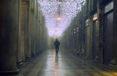 Man walking through empty bank lobby | Ekaterina Nosenko/Moment Open/Getty Images