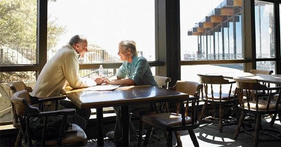 Senior couple seated at a restaurant table | Siri Stafford/Getty Images