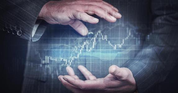 Businessman holding investing globe concept between hands | da-kuk/E+/Getty Images