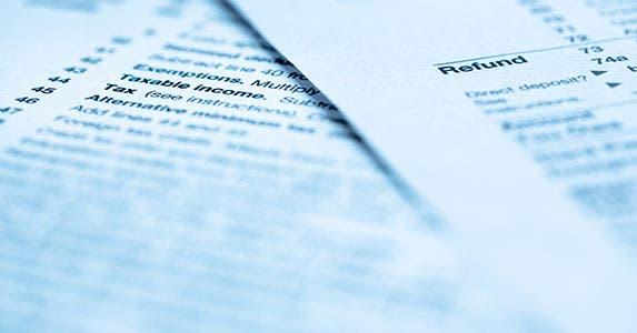 Tax preparation © topseller/Shutterstock.com