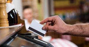 Man in restaurant paying with a card © Khakimullin Aleksandr/Shutterstock.com