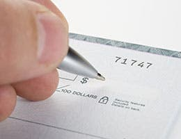 Accepting checks © Nikola Bilic/Shutterstock.com