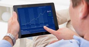Man analyzing graph on digital tablet © Andrey_Popov/Shutterstock.com