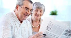 Retired couple reading paper © Pressmaster/Shutterstock.com