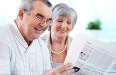 Retired couple reading paper © Pressmaster/Shutterstock.com