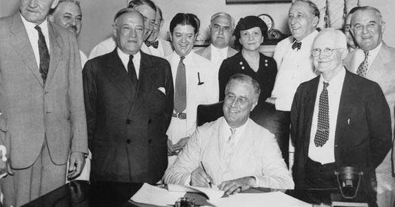 Former president Franklin D. Roosevelt signed the Social Security Act in 1935