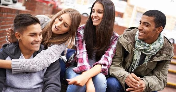 Millennial friends hanging out | PeopleImages/Getty Images