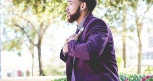 Young man wearing purple suit | William Stitt/Unsplash