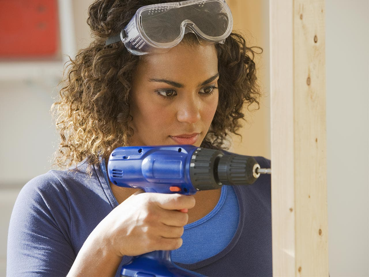 Woman with powerdrill