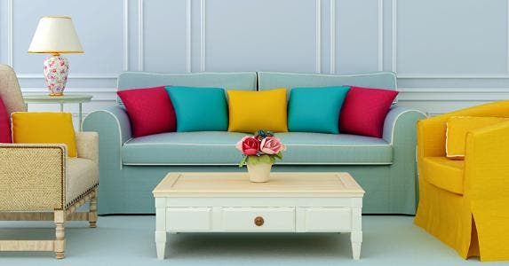 Blue living room with blue sofa and colorful pillows © JZhuk/Shutterstock.com